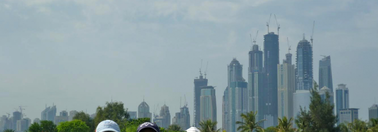 Us on the golf course with Dubai in the background